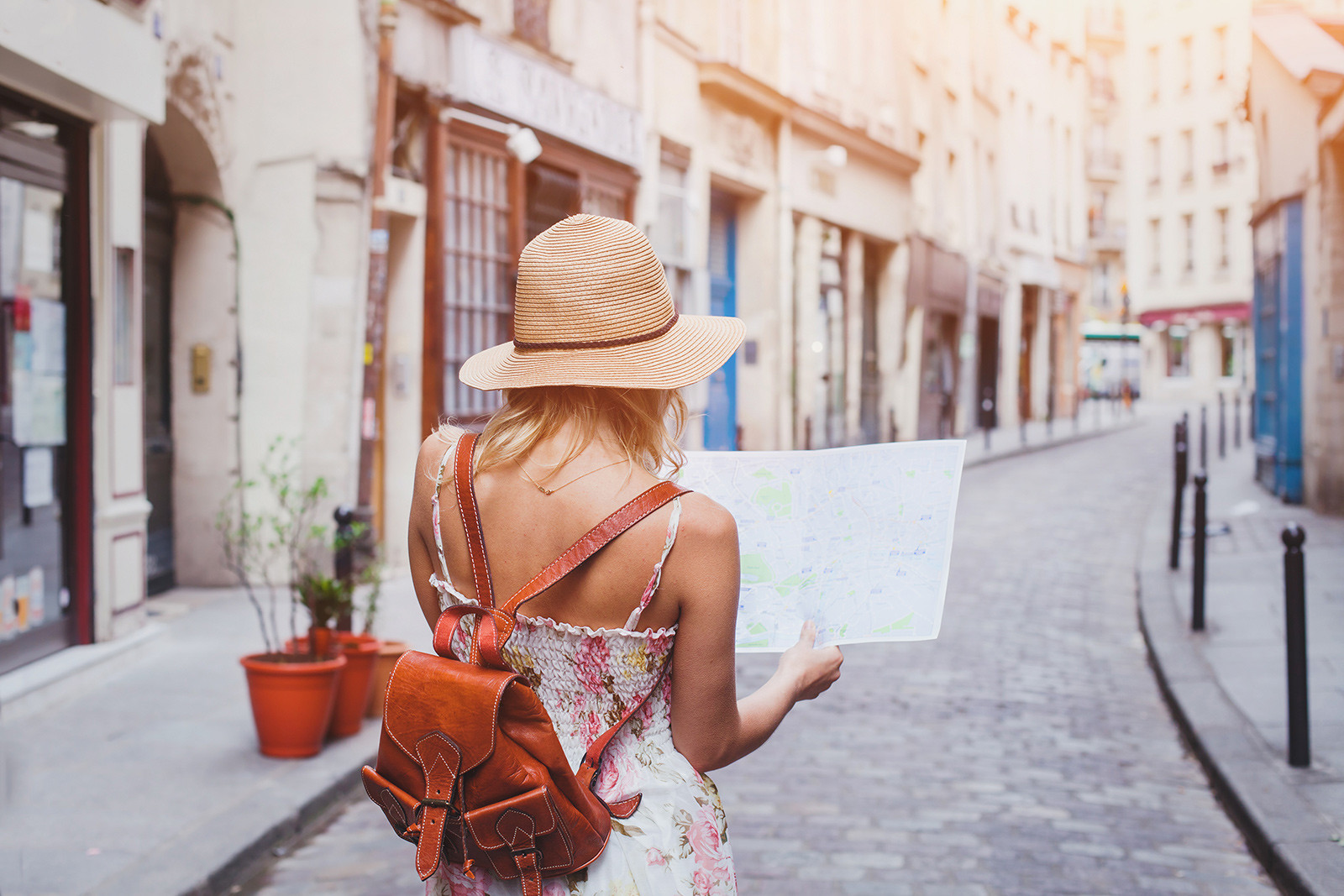 Woman tourist with map on the street