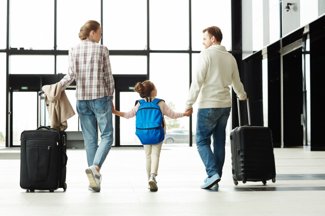 Travel Insurance Family Walking Airport